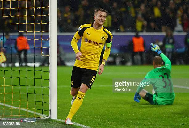 Marco Reus of Borussia Dortmund celebrates scoring his teams fifth goal with teammate Marc Bartra during the UEFA Champions League Group F match...