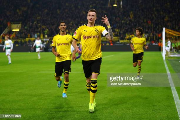 Marco Reus of Borussia Dortmund celebrates scoring his teams first goal of the game during the Bundesliga match between Borussia Dortmund and...