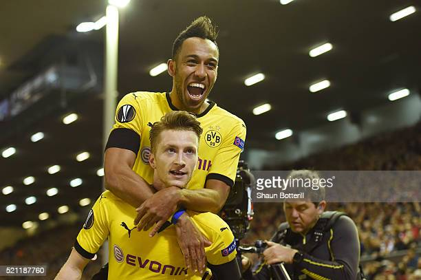 Marco Reus of Borussia Dortmund celebrates scoring his team's third goal with PierreEmerick Aubameyang during the UEFA Europa League quarter final...