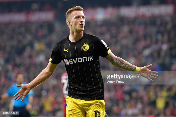 Marco Reus of Borussia Dortmund celebrates scoring the first goal during the Bundesliga match between FC Bayern Muenchen and Borussia Dortmund at...