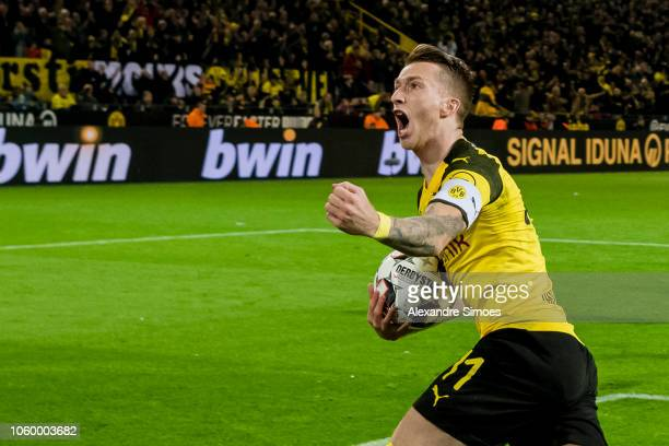 Marco Reus of Borussia Dortmund celebrates scoring the goal to the 11 via penalty kick during the Bundesliga match between Borussia Dortmund and FC...