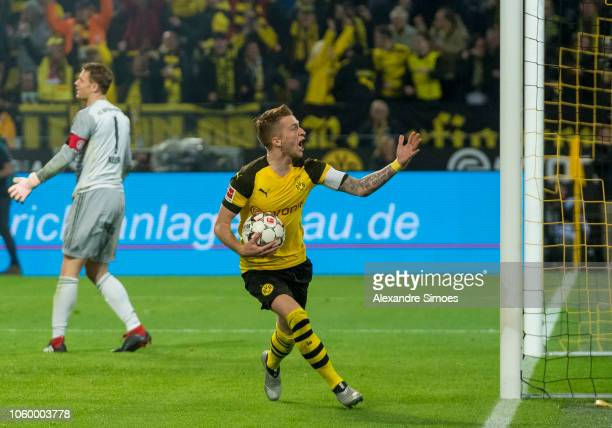 Marco Reus of Borussia Dortmund celebrates scoring the goal to the 11 via penalty kick during the Bundesliga match between Borussia Dortmund and FC...
