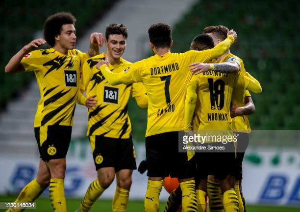 Marco Reus of Borussia Dortmund celebrates scoring the goal to the 1:2 via penalty kick during the Bundesliga match between SV Werder Bremen and...