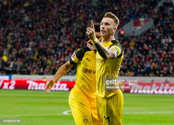 Marco Reus of Borussia Dortmund celebrates scoring the goal to the 22 during the Bundesliga match between Bayer 04 Leverkusen and Borussia Dortmund...