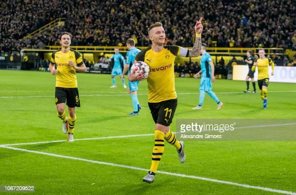 Marco Reus of Borussia Dortmund celebrates scoring the opening goal via penalty kick during the Bundesliga match between Borussia Dortmund and SC...