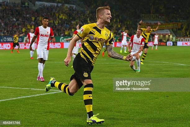 Marco Reus of Borussia Dortmund celebrates scoring the opening goal during the Bundesliga match between FC Augsburg and Borussia Dortmund at SGL...