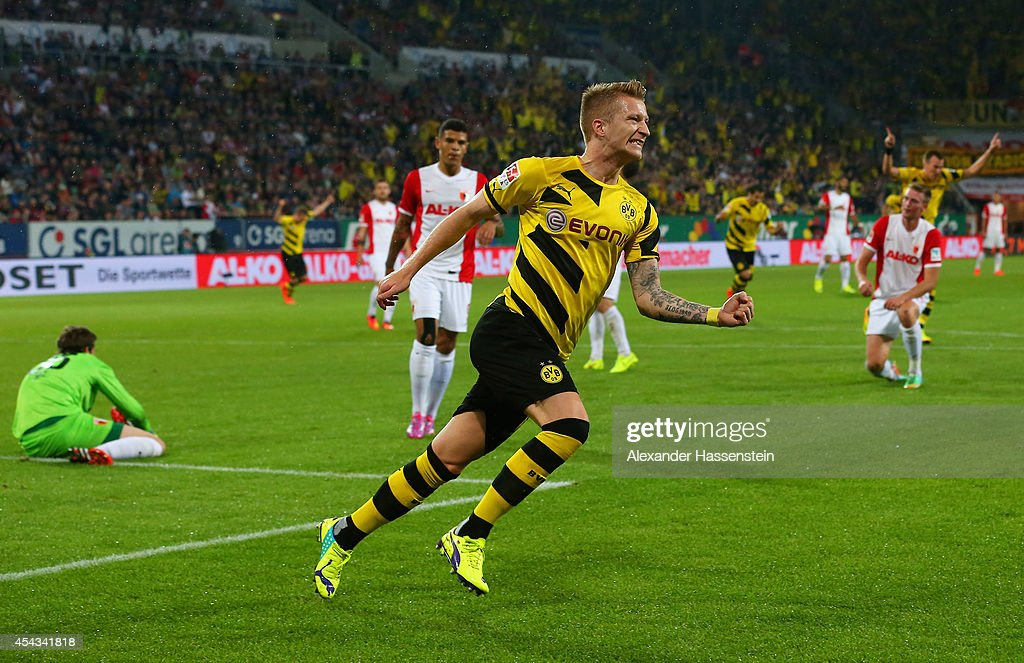 Marco Reus of Borussia Dortmund celebrates scoring the opening goal during the Bundesliga match between FC Augsburg and Borussia Dortmund at SGL Arena on August 29, 2014 in Augsburg, Germany.