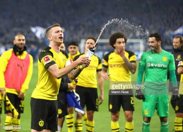 Marco Reus of Borussia Dortmund celebrates victory after the Bundesliga match between FC Schalke 04 and Borussia Dortmund at VeltinsArena on December...