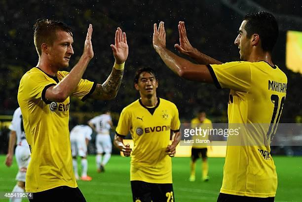 Marco Reus of Borussia Dortmund celebrates with Henrikh Mkhitaryan of Borussia Dortmund after scoring his teams third goal the UEFA Europa League...