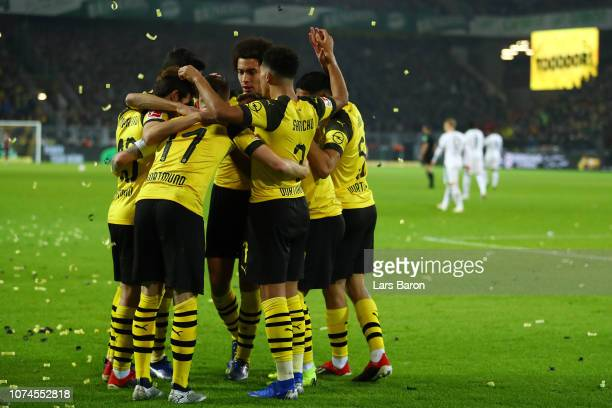 Marco Reus of Borussia Dortmund celebrates with his team mates after scoring his side's second goal during the Bundesliga match between Borussia...