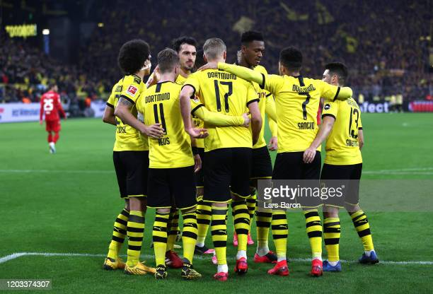 Marco Reus of Borussia Dortmund celebrates with his team mates after scoring his team's third goal during the Bundesliga match between Borussia...