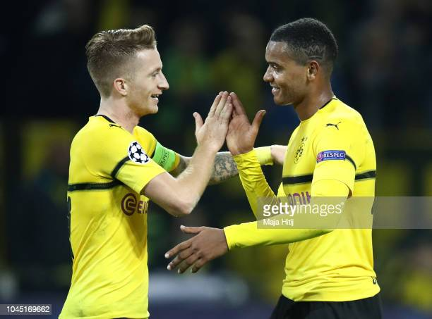 Marco Reus of Borussia Dortmund celebrates with Manuel Akanji of Borussia Dortmund after scoring his team's third goal during the Group A match of...