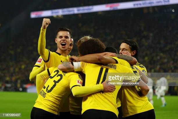 Marco Reus of Borussia Dortmund celebrates with team mates after scoring his team's first goal during the Bundesliga match between Borussia Dortmund...