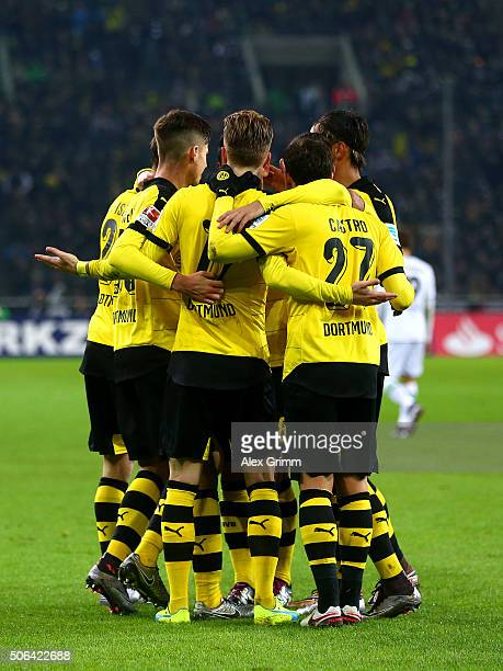 Marco Reus of Borussia Dortmund celebrates with team mates as he scores their first goal during the Bundesliga match between Borussia...
