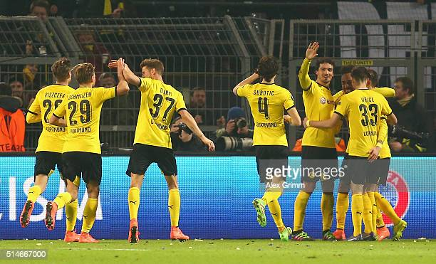 Marco Reus of Borussia Dortmund celebrates with team mates as he scores their second goal during the UEFA Europa League Round of 16 first leg match...