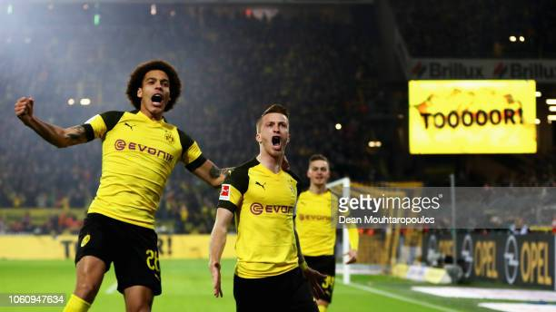 Marco Reus of Borussia Dortmund celebrates with teammate Axel Witsel after scoring his team's first goal during the Bundesliga match between Borussia...