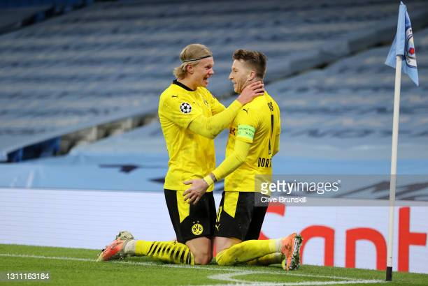 Marco Reus of Borussia Dortmund celebrates with teammate Erling Haaland after scoring their team's first goal during the UEFA Champions League...