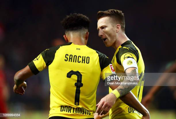 Marco Reus of Borussia Dortmund celebrates with teammate Jadon Sancho after scoring his team's second goal during the Bundesliga match between...