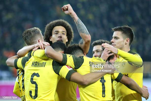 Marco Reus of Borussia Dortmund celebrates with teammates after scoring his team's second goal during the Bundesliga match between Borussia Dortmund...