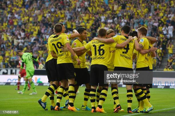 Marco Reus of Borussia Dortmund celebrates with teammates after scoring his team's first goal during the DFL Supercup match between Borussia Dortmund...