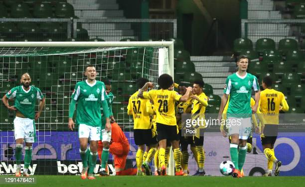 Marco Reus of Borussia Dortmund celebrates with teammates after scoring their sides second goal from the penalty spot during the Bundesliga match...
