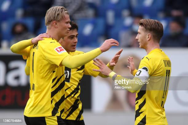 Marco Reus of Borussia Dortmund celebrates with teammates Erling Haaland and Giovanni Reyna after scoring his sides first goal during the Bundesliga...
