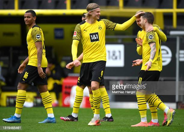 Marco Reus of Borussia Dortmund celebrates with teammates Erling Haaland and Julian Brandt after scoring his team's second goal during the Bundesliga...