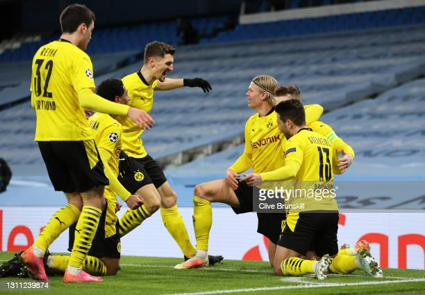 Marco Reus of Borussia Dortmund celebrates with teammates Raphael Guerreiro, Erling Haaland and Jude Bellingham after scoring their team's first goal...