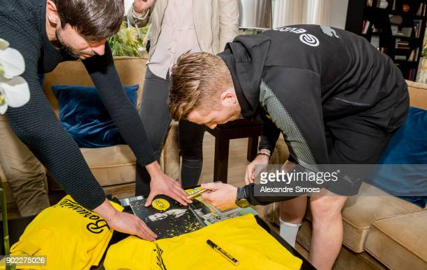 Marco Reus of Borussia Dortmund gives autographs during an interview session with the press as part of the training camp at the Estadio Municipal de...