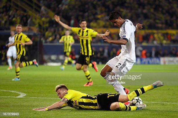 Marco Reus of Borussia Dortmund goes down under the challenge from Raphael Varane of Real Madrid in the area during the UEFA Champions League semi...