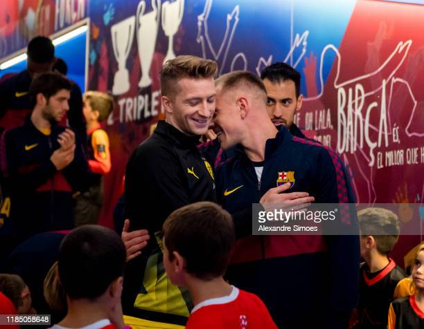 Marco Reus of Borussia Dortmund greets Marc-Andre ter Stegen of Barcelona prior to the Group F - UEFA Champions League match between FC Barcelona and...