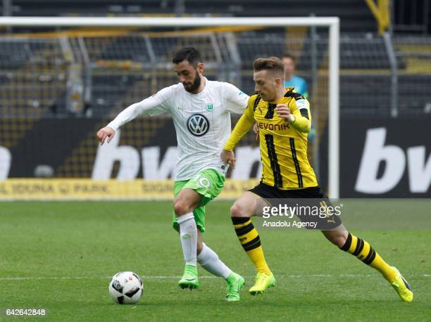 Marco Reus of Borussia Dortmund in action against Yunus Malli of VfL Wolfsburg during the Bundesliga soccer match between Borussia Dortmund and VfL...