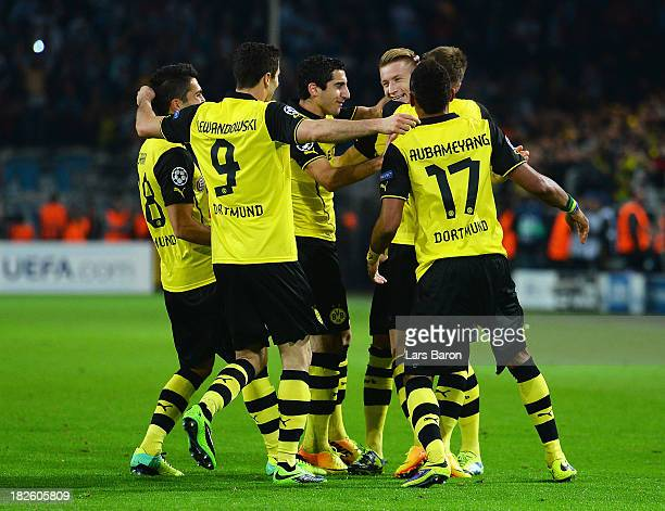 Marco Reus of Borussia Dortmund is congratulated by team mates after scoring his team's second goal during the UEFA Champions League Group F match...