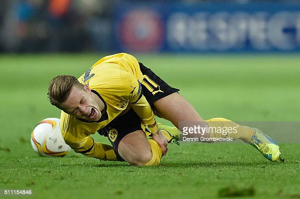 Marco Reus of Borussia Dortmund lies injured during the UEFA Europa League round of 32 first leg match between Borussia Dortmund and FC Porto at...