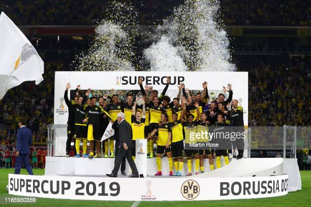 Marco Reus of Borussia Dortmund lifts the DFL Super Cup Trophy following his team's victory in the DFL Supercup 2019 match between Borussia Dortmund...