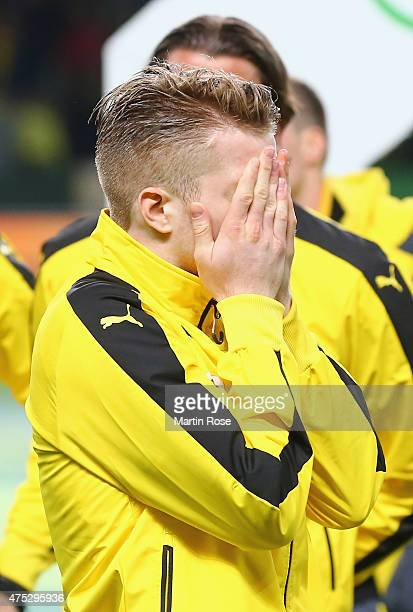 Marco Reus of Borussia Dortmund looks dejected after loosing the DFB Cup Final match between Borussia Dortmund and VfL Wolfsburg at Olympiastadion on...