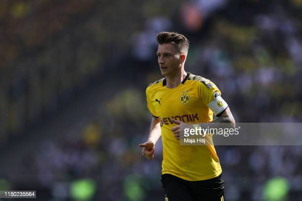 Marco Reus of Borussia Dortmund looks on during the Bundesliga match between Borussia Moenchengladbach and Borussia Dortmund at BorussiaPark on May...