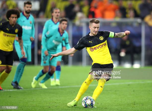Marco Reus of Borussia Dortmund misses a penalty as it is saved by MarcAndré ter Stegen of FC Barcelona during the UEFA Champions League group F...