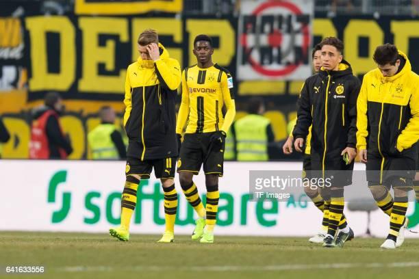 Marco Reus of Borussia Dortmund Ousmane Dembele of Borussia Dortmund Emre Mor of Borussia Dortmund and Raphael Guerreiro of Borussia Dortmund looks...