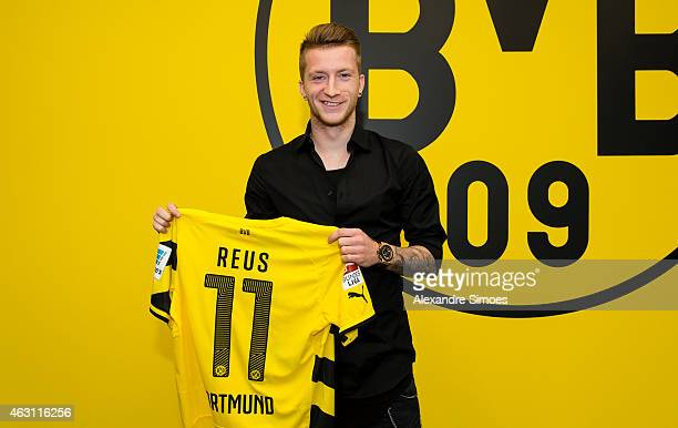 Marco Reus of Borussia Dortmund poses with his shirt after his contract extension during Borussia Dortmund's press conference at Signal Iduna Park on...