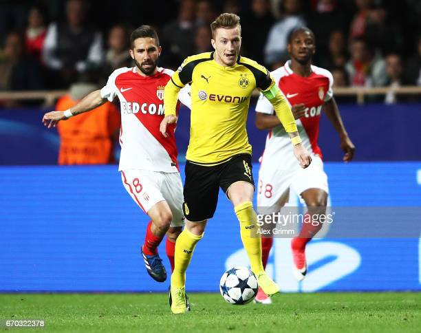 Marco Reus of Borussia Dortmund races away from Joao Moutinho of Monaco during the UEFA Champions League Quarter Final second leg match between AS...
