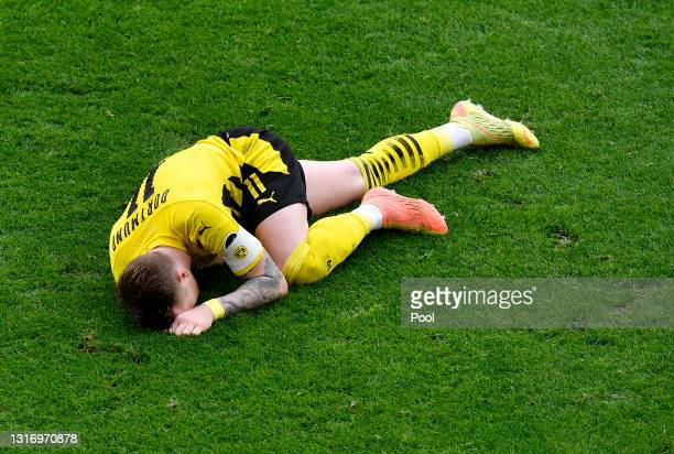Marco Reus of Borussia Dortmund reacts as he lies injured during the Bundesliga match between Borussia Dortmund and RB Leipzig at Signal Iduna Park...