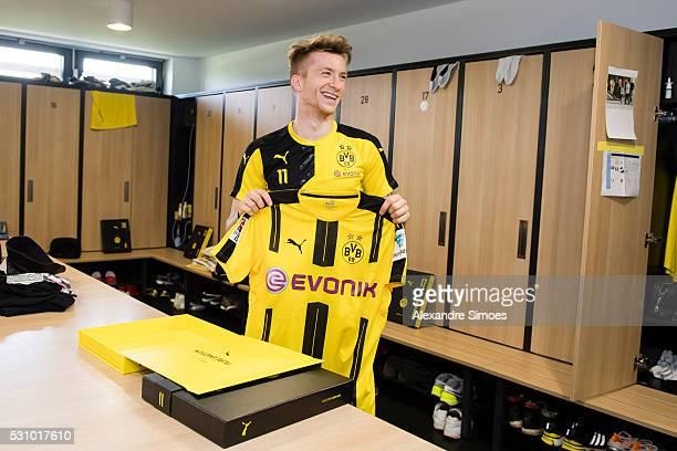 Marco Reus of Borussia Dortmund revealing the new Borussia Dortmund home jersey Season 20162017 on May 12 2016 in Dortmund Germany