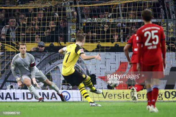 Marco Reus of Borussia Dortmund scores a penalty for his team's first goal during the Bundesliga match between Borussia Dortmund and FC Bayern...