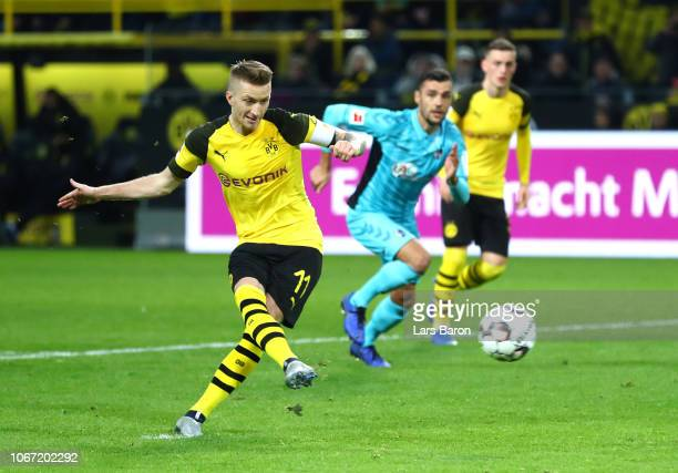 Marco Reus of Borussia Dortmund scores a penalty for his team's first goal during the Bundesliga match between Borussia Dortmund and SportClub...