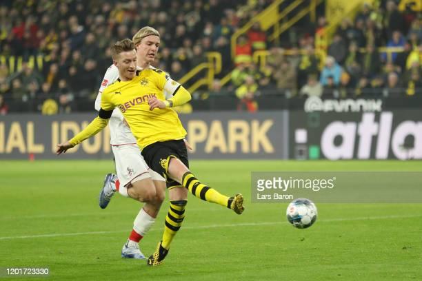 Marco Reus of Borussia Dortmund scores his sides second goal during the Bundesliga match between Borussia Dortmund and 1 FC Koeln at Signal Iduna...