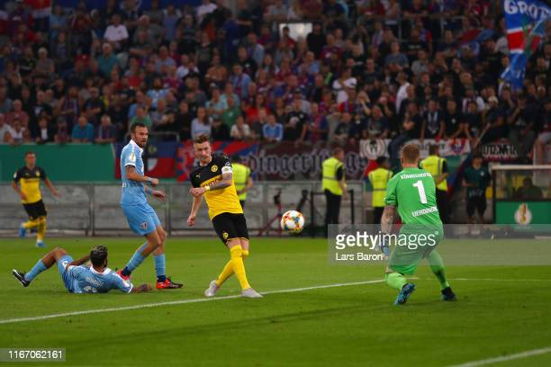 Marco Reus of Borussia Dortmund scores his team's first goal during the DFB Cup first round match between KFC Uerdingen and Borussia Dortmund at...
