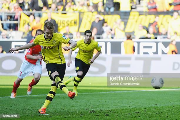 Marco Reus of Borussia Dortmund scores his team's fourth goal during the Bundesliga match between Borussia Dortmund and 1 FSV Mainz 05 at Signal...