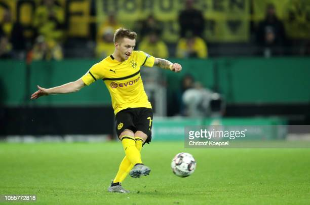 Marco Reus of Borussia Dortmund scores his team's third goal during the DFB Cup match between Borussia Dortmund and 1 FC Union Berlin at Signal Iduna...