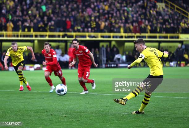 Marco Reus of Borussia Dortmund scores his team's third goal from the penalty spot during the Bundesliga match between Borussia Dortmund and 1. FC...